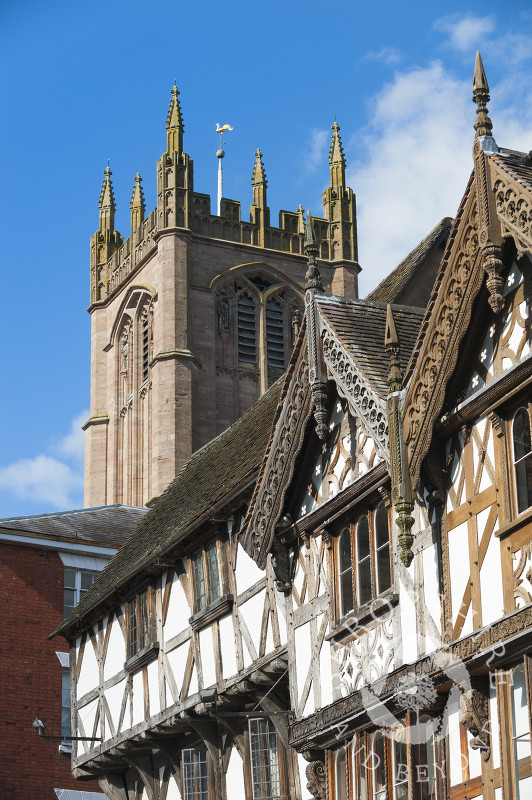 St Laurence's Church towers above half-timbered buildings in Ludlow, Shropshire, England.