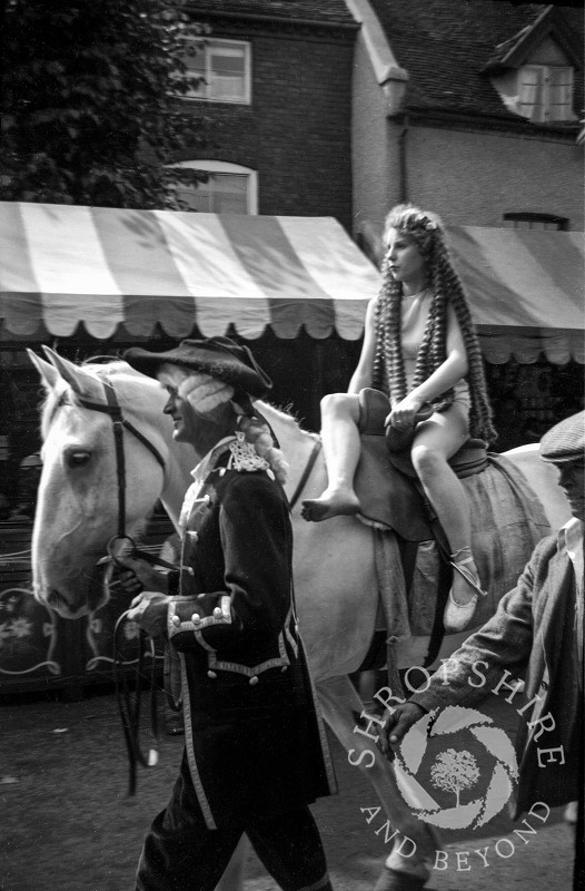 Lady Godiva on horseback at the annual carnival parade in Shifnal, Shropshire, during the 1950s.