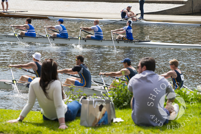 Spectators enjoy the spring sunshine at Shrewsbury Regatta on the River Severn, Shropshire.