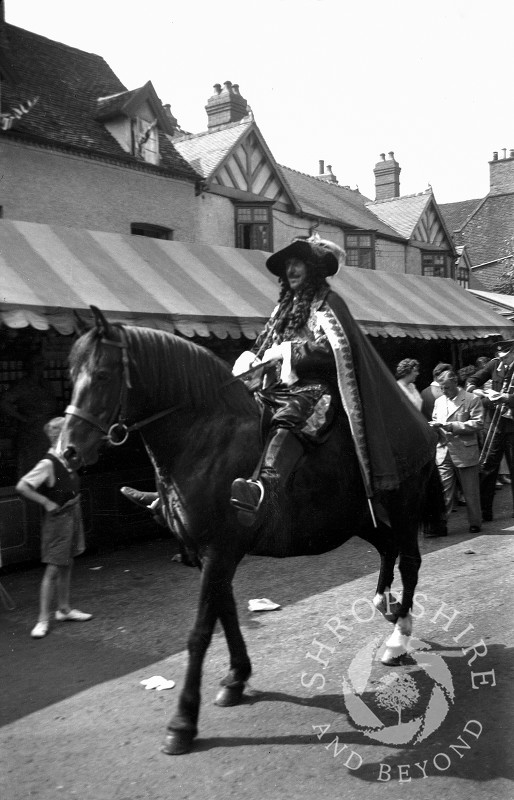 A character on horseback at the annual carnival parade in Shifnal, Shropshire, during the 1950s.