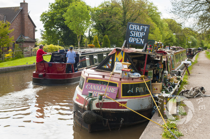 A craft shop on board a canal boat moored on the Shropshire Union Canal at Market Drayton, Shropshire, England.