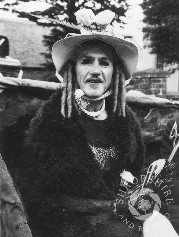 Carnival character on one of the floats in Shrewsbury Road, Shifnal, Shropshire, in the 1950s.