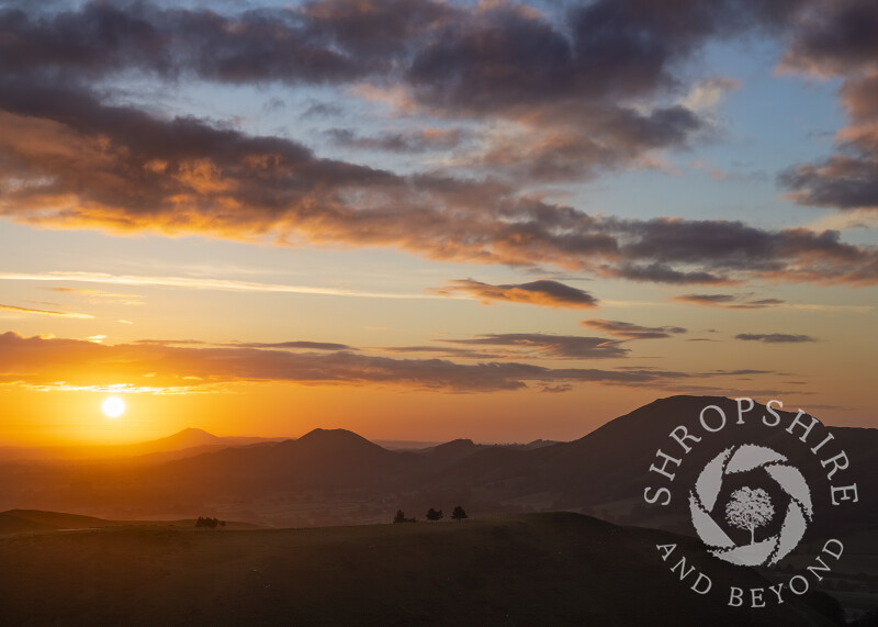 The Stretton Hills and the Wrekin at sunrise, seen from the Long Mynd, Shropshire.