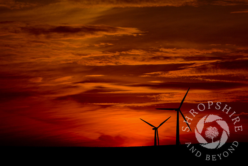 Sunset behind the wind farm at Carno in Powys, Mid Wales.
