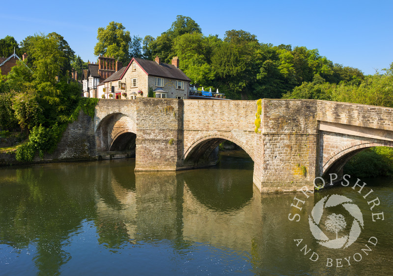 Ludford Bridge reflected in the waters of the River Teme at Ludlow, Shropshire, England.