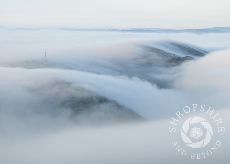 A blanket of fog envelops Helmeth Hill, and Hazler Hill, seen from Caradoc, Shropshire.