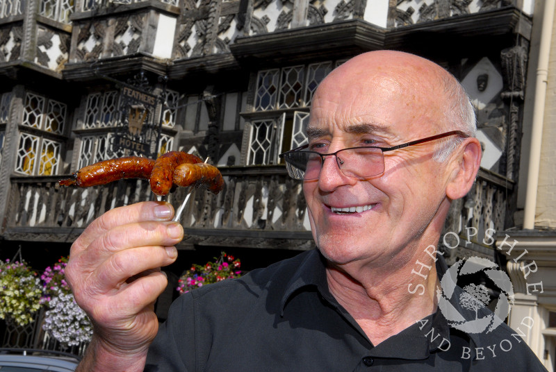 A visitor takes part in the Sausage Trail at Ludlow Food Festival, Shropshire, England.