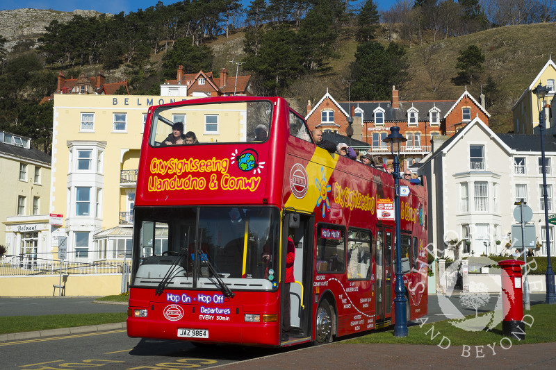 A sightseeing bus on the seafront in Llandudno, North Wales.