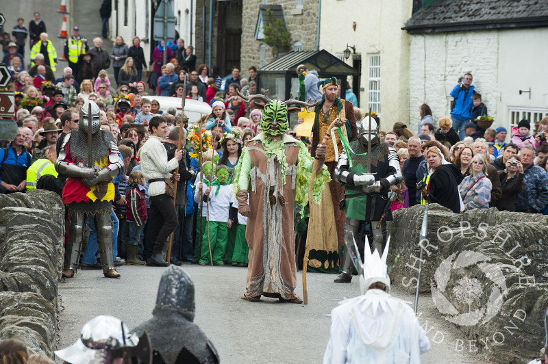 The Green Man confronts the Frost Queen on the bridge during the Clun Green Man Festival in Shropshire.