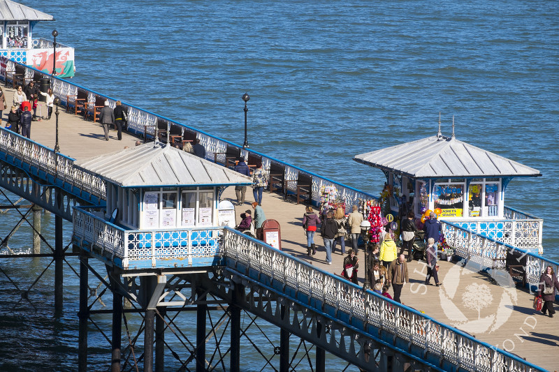 Visitors throng the pier at Llandudno, north Wales.