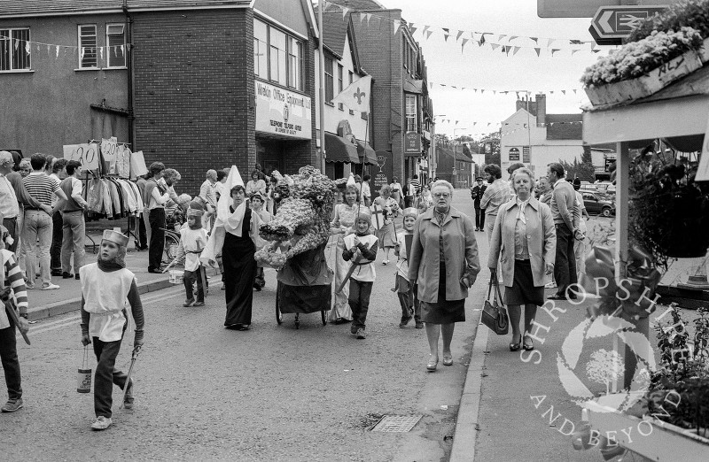 Shifnal Cubs take part in the annual carnival parade at Shifnal,  Shropshire, in June 1987.