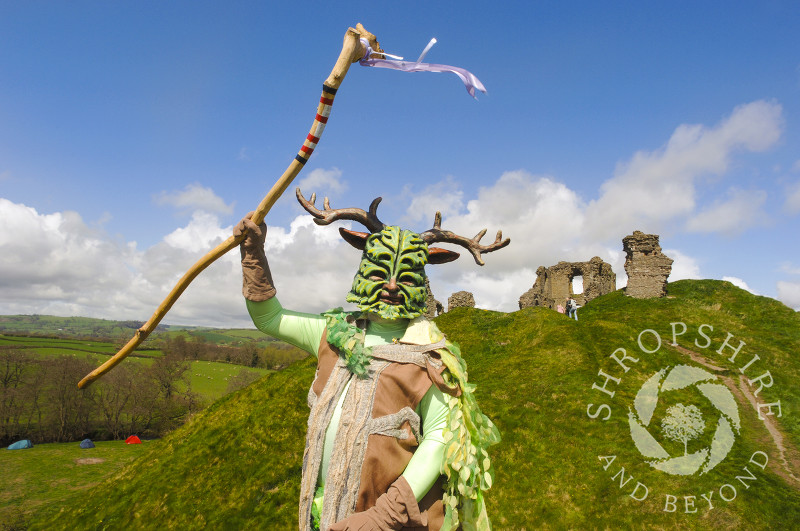 The Green Man in front of Clun Castle, Clun Green Man Festival, Shropshire.