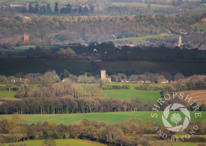 The view from Brown Clee, Shropshire, with St Giles' Church at Chetton in the foreground. In the distance are St Leonard's Church and St Mary's Church at Bridgnorth.