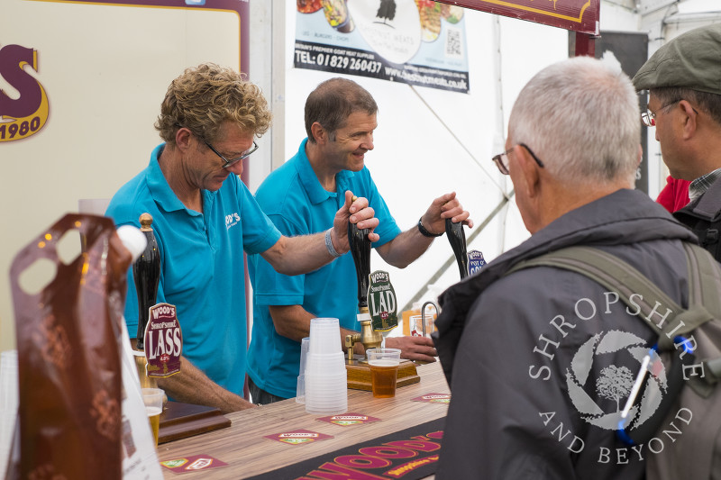 Beer being pulled on the Wood's Brewing Company stall at Ludlow Food Festival, Shropshire.