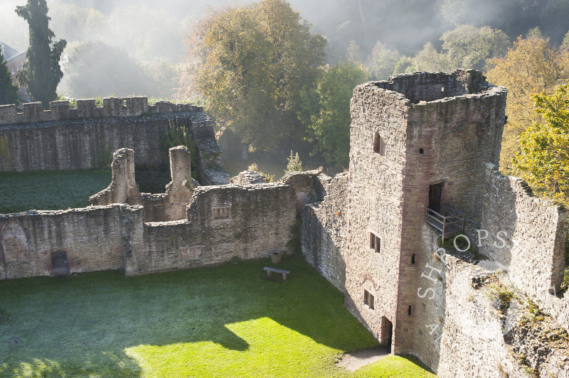 Smoke from a bonfire drifts across the grounds of Ludlow Castle, Shropshire, England.