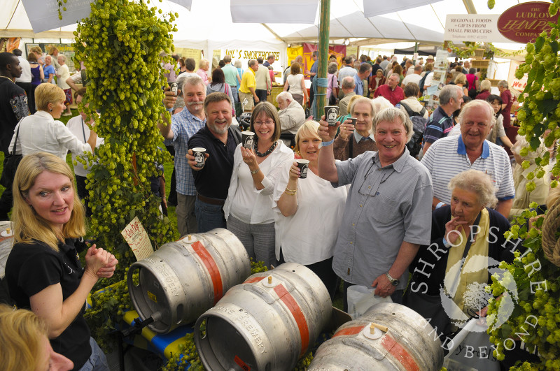Visitors to the Hobsons Brewery stall at Ludlow Food Festival, Shropshire, England.