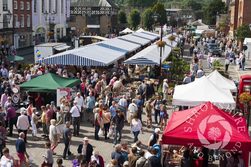 Shoppers and stalls fill the Castle Square during Ludlow Food Festival, Shropshire, England.