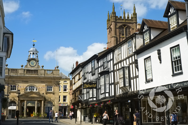 Looking up Broad Street to the Buttercross and St Laurence's Church, Ludlow, Shropshire, England.