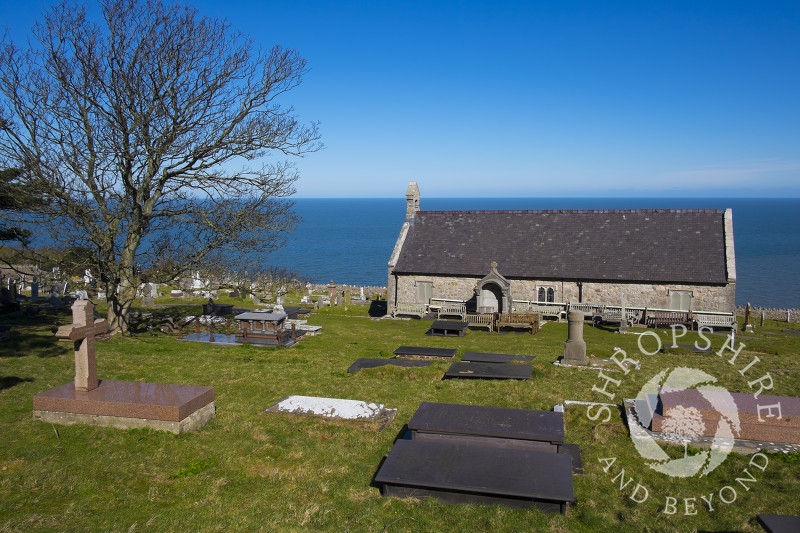 The Church of St Tudno with its churchyard and the adjacent town cemetery on the Great Orme, Llandudno, Wales.