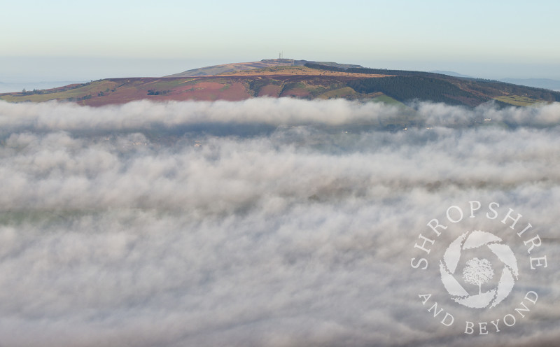 Mist swirls around Brown Clee Hill in Shropshire.