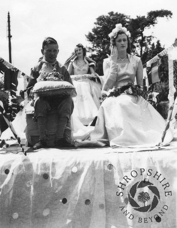 The Carnival Queen float in Shifnal, Shropshire, during the town's annual carnival, 1950s.