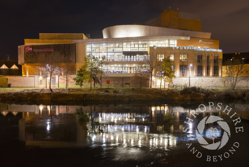 Theatre Severn reflected in the River Severn at Shrewsbury, Shropshire.