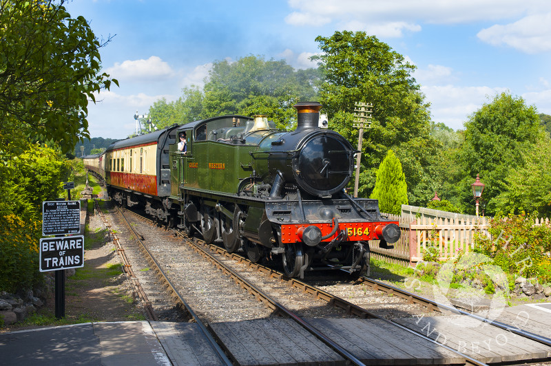 A GWR 5164 Large Prairie steam locomotive pulls into Hampton Loade Station, Severn Valley Railway, Shropshire, England.
