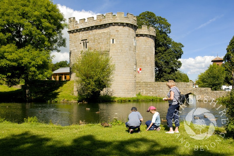Feeding the ducks at Whittington Castle near Oswestry, Shropshire, England.