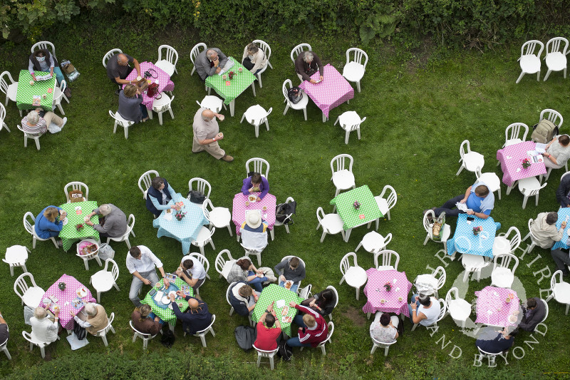 Visitors take a break in the castle grounds at the 2014 Ludlow Food Festival, Shropshire, England.
