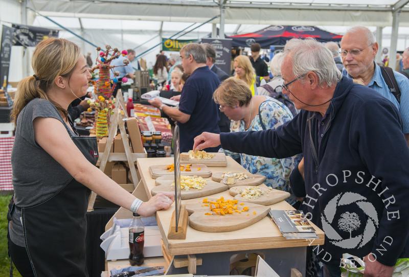 Visitors sample a selection of cheeses at Ludlow Food Festival, Shropshire.