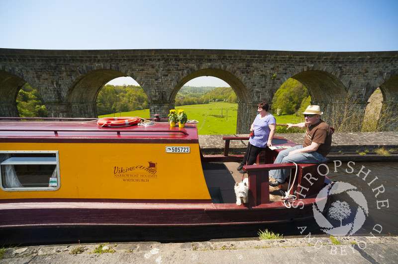 A canal boat on the Llangollen Canal at Chirk Aqueduct, on the England/Wales border.