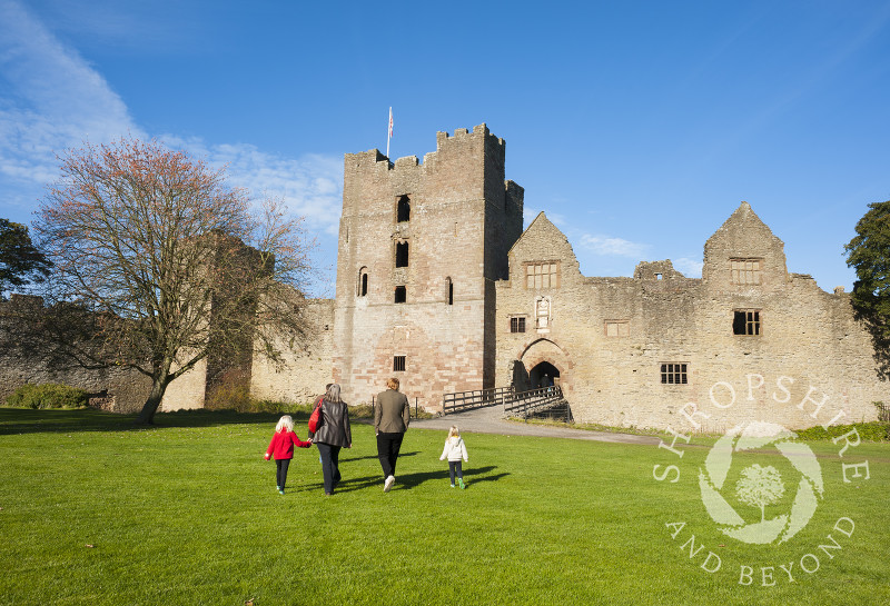 Visitors stroll through the Outer Bailey at Ludlow Castle, Shropshire, England.