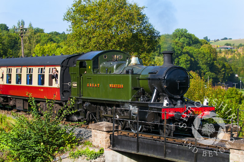 A GWR 4500 Class locomotive leaves Highley Station, Severn Valley Railway, Shropshire, England.