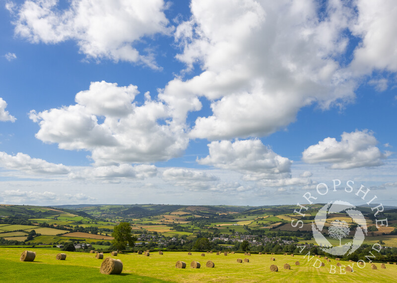 Hay bales overlooking the town of Clun in south Shropshire.
