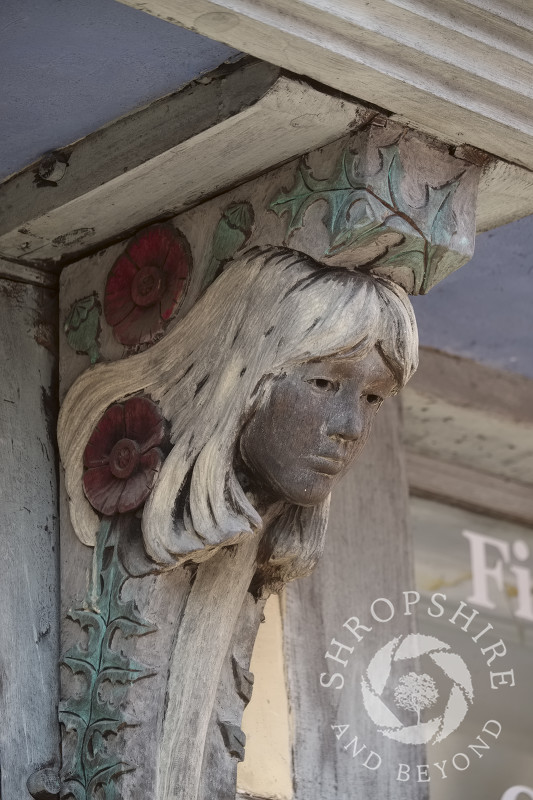 Wooden carving on the Elizabethan Porch House in Bishop's Castle, Shropshire, England.