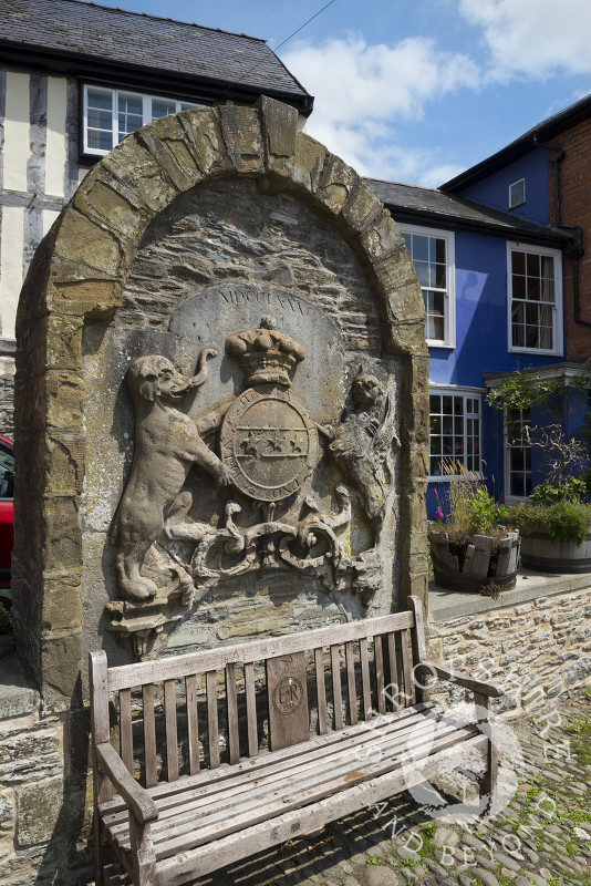 The coat of arms of the Earls of Powis in the Old Market Place, Bishop's Castle, Shropshire, England. The stone is a relic of the old market hall.